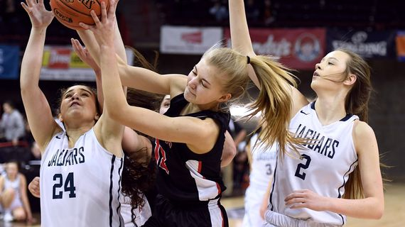 St. George's forward Hadlie Kaiser  grabs a rebound away from Tri-Cities Prep guard Alyssa Monteon (24) and forward Makenna Brandner (2) during Wednesday's State 2B play at  the Spokane Arena. (Colin Mulvany / The Spokesman-Review)