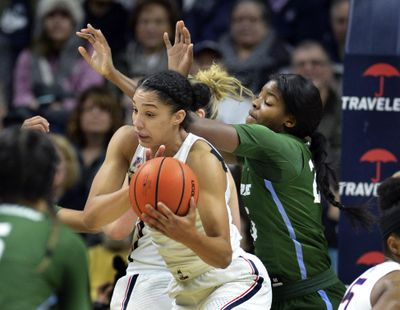 UConn's Gabby Williams grabs a rebound against Tulane's Harlyn Wyatt in the first half on Saturday in Storrs, Connecticut. The unbeaten, top-ranked Huskies won, 98-45. (Stephen Dunn / Associated Press)