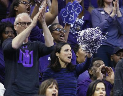 Actress Julia Louis-Dreyfus, center, watches her team Northwestern play against Gonzaga during the first half of a second-round college basketball game in the men's NCAA Tournament, Saturday, March 18, 2017, in Salt Lake City. (George Frey / Associated Press)
