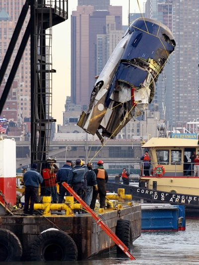 The left engine of US Airways Flight 1549  – which crash-landed into the water on Jan. 15 – can be seen as it is retrieved from the icy Hudson River in New York on Friday.  (Associated Press / The Spokesman-Review)