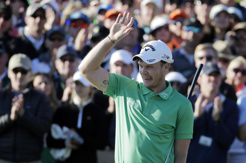 Danny Willett, of England, celebrates on the 18th hole after finishing the final round at Augusta National on Sunday. (Charlie Riedel / Associated Press)