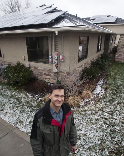 A solar panel array installed on s Boise office space as well as a home. (Darin Oswald / Idaho Statesman)