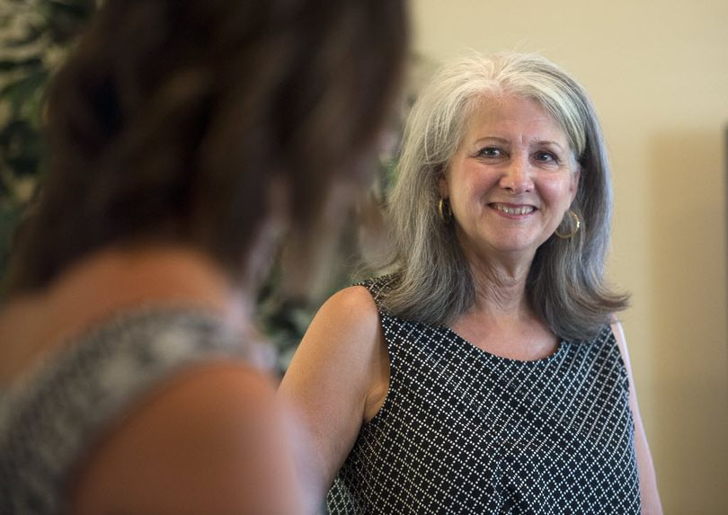 LaVerne Biel visits with her daughter, Brita Frost as they prepare for guests on election night, Aug. 4, 2015. (Dan Pelle / The Spokesman-Review)