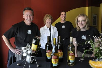 From left: Steve and Dana Trabun, along with Russ and Marlene Feist, have opened Barili Cellars at Second and Howard in downtown Spokane. (Dan Pelle / The Spokesman-Review)