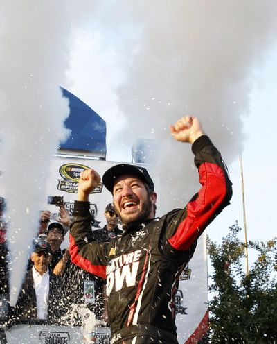 Martin Truex Jr. celebrates in Victory Circle after winning in the third race of NASCAR's Sprint Cup Chase series. (Mel Evans / Associated Press)