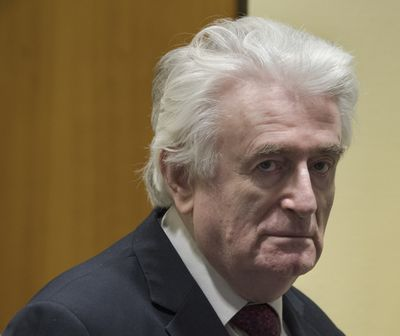 FILE - In this Wednesday, March 20, 2019 file photo, former Bosnian Serb leader Radovan Karadzic enters the court room of the International Residual Mechanism for Criminal Tribunals in The Hague, Netherlands. The British government said Wednesday, May 12, 2021 that former Bosnian Serb leader Radovan Karadzic will serve his life sentence for war crimes in a U.K. prison. Karadzic, one of the chief architects of the slaughter and devastation of Bosnia's 1992-95 war, was convicted in 2016 by a United Nations court of genocide, crimes against humanity and war crimes.  (Peter Dejong)