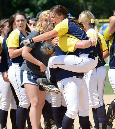 Center fielder Shalaina Duford is scooped up by teammate Lexi Miller as the Sasquatch celebrate their NWAC championship.