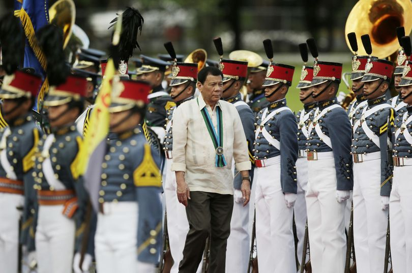 Philippine President Rodrigo Duterte inspects troops during the 81st anniversary of the Armed Forces of the Philippines at Camp Aguinaldo military headquarters in Quezon city, north of Manila, Philippines, on Dec. 21. (Aaron Favila / Associated Press)