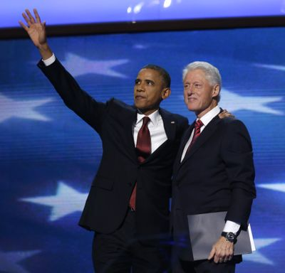 President Barack Obama waves as he joins Former President Bill Clinton during the Democratic National Convention in Charlotte, N.C., on Wednesday, Sept. 5, 2012. (Charles Dharapak / Associated Press)
