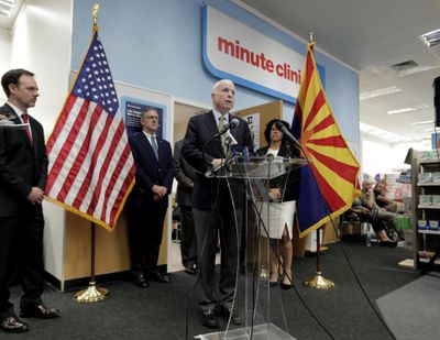 """U.S. Sen. John McCain, R-Ariz., speaks Tuesday at a CVS """"MinuteClinic"""" in Tempe, Ariz. to announce a pilot program that allows ailing veterans who receive treatment at the Phoenix VA medical center to access one of 24 """"MinuteClinics"""" operated by CVS for treatment of minor illnesses and injuries, such as respiratory infections or to order lab tests. Three years after a wait-time scandal, the Veterans Affairs Department is hoping a private-sector partnership with the CVS Pharmacy chain will reduce some of its strain in providing timely urgent care. (Matt York / Associated Press)"""