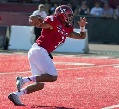 Eastern Washington University QB Vernon Adams (3) cuts hard to find a path to the end zone for a score against Idaho State in the second quarter, Oct. 4, 2014, in Cheney, Wash. (Dan Pelle / The Spokesman-Review)