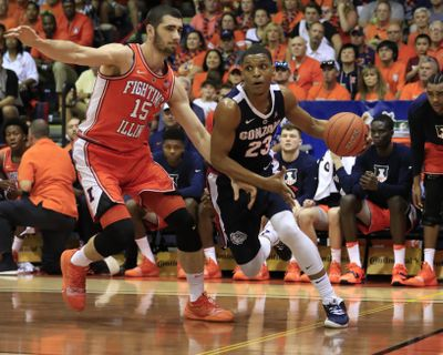 Gonzaga guard Zach Norvell Jr. dribbles past Illinois forward Giorgi Bezhanishvili during the first half of a first-round game at the Maui Invitational on Monday. (Marco Garcia / Associated Press photos)