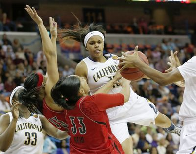 Brittany Boyd and Cal ran into the buzzsaw defense of Cortnee Walton (13), Monique Reid (33) and Louisville on Sunday. (Associated Press)