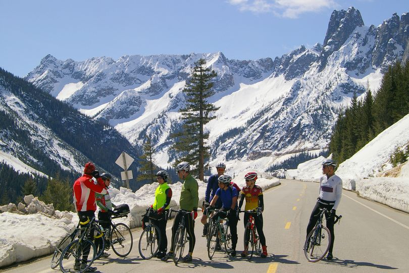 Cyclists from the Mazama area enjoy riding the North Cascades Highway vehicle-free while Washington Department of Transportation crews work to clear snow.