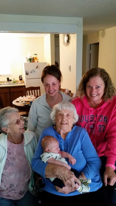 Myrle Collins holds her great-great-grandson, Tristan Domke, both of Spokane Valley. Also pictured, clockwise from left, are her daughter, Myrlene Haskell of Spokane; great-granddaughter, Kaleena Domke of Spokane Valley; and granddaughter, Becky Key of Otis Orchards.