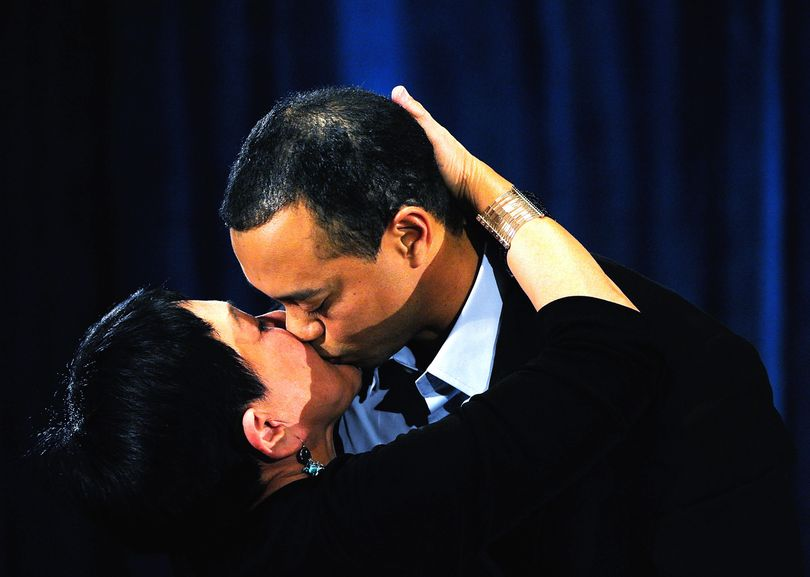 Tiger Woods hugs his mother Kultida Woods after making a statement at the Sawgrass Players Club, Friday, Feb. 19, 2010, in Ponte Vedra Beach, Fla. (Sam Greenwood / Getty Images Pool)