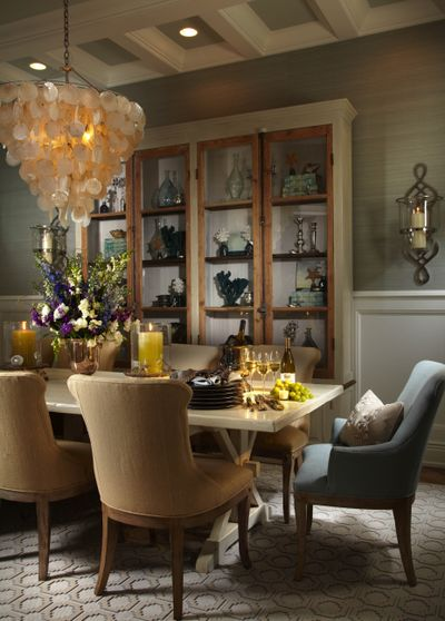 A shell chandelier inspired by nature in a coastal dining room.