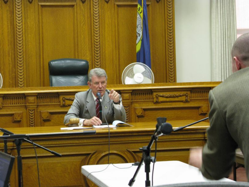 Gov. Butch Otter speaks to state Lands Department employee Patrick Hodges at the start of a special Land Board meeting on Wednesday (Betsy Russell)