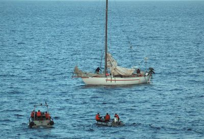This  photo provided Friday by the French navy shows negotiators and members of the  navy on boats near the  sailboat Tanit, off the coast of Somalia. France's navy stormed  the sailboat Friday. (Associated Press / The Spokesman-Review)