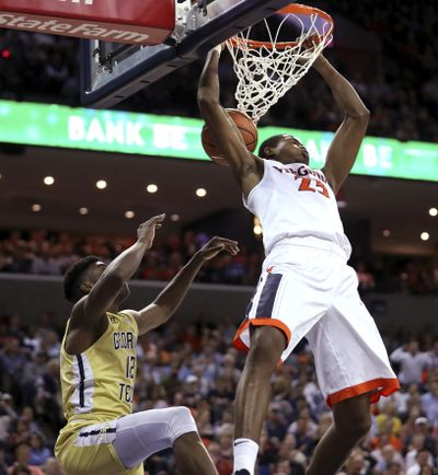 Virginia's Nigel Johnson (23) dunks over Georgia Tech's Moses Wright (12) during the second half of an NCAA college basketball game Wednesday, Feb. 21, 2018, in Charlottesville, Va. (Zach Wajsgras / Daily Progress via AP)