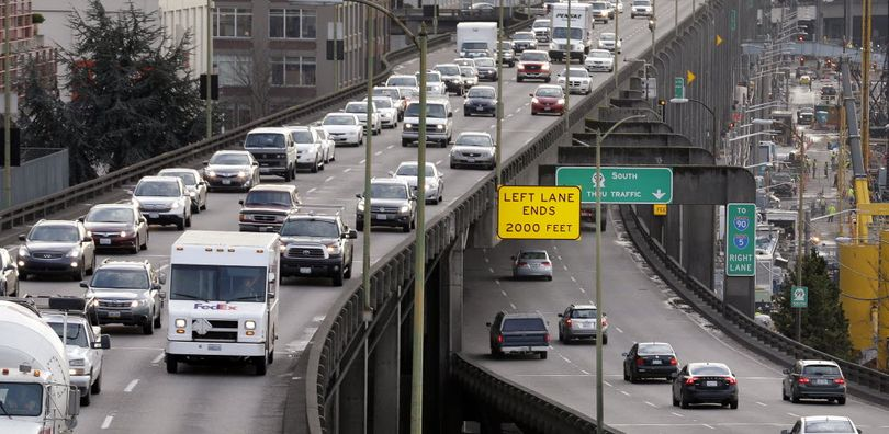 Northbound traffic backs-up on the upper deck of the Alaskan Way Viaduct, left, as southbound vehicles enter the lower deck, in downtown Seattle on Dec. 8, 2014.  (AP Photo/Elaine Thompson)