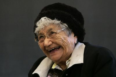 A native speaker of Yakama Sahaptin, elder Virginia Beavert, 87, shares a laugh with her students during a class.  (Associated Press / The Spokesman-Review)