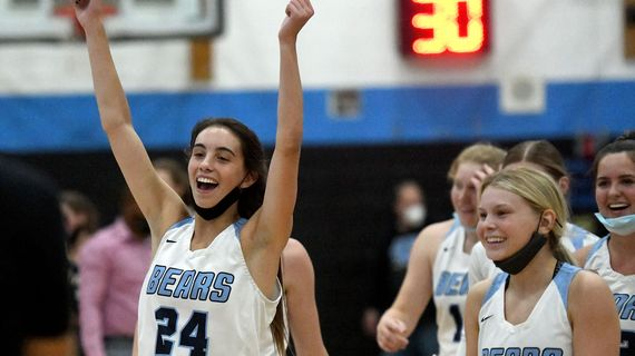 Central Valley's Chloe Williams (24) celebrates after her Bears defeated Mead 63-60 during the East Region championship game at Central Valley on Wednesday.  (Kathy Plonka/The Spokesman-Review)