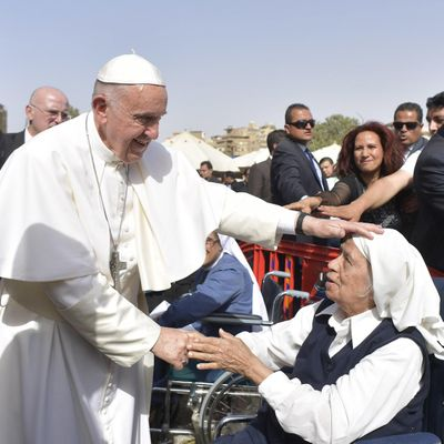 Pope Francis caresses a nun during a meeting with the clergy and religious in Cairo, Saturday, April 29, 2017. Pope Francis came to Egypt on Friday for a historic visit to the Arab and Muslim majority nation aimed at presenting a united Christian-Muslim front to repudiate violence committed in God's name. (Associated Press)