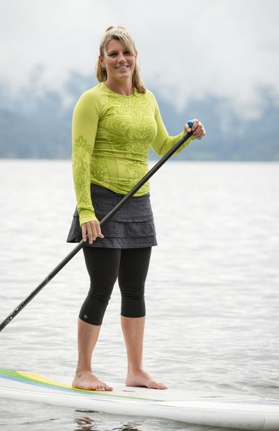 Kym Murdock, owner of CDA Paddleboard, paddles in Lake Coeur d'Alene. (Jed Conklin)