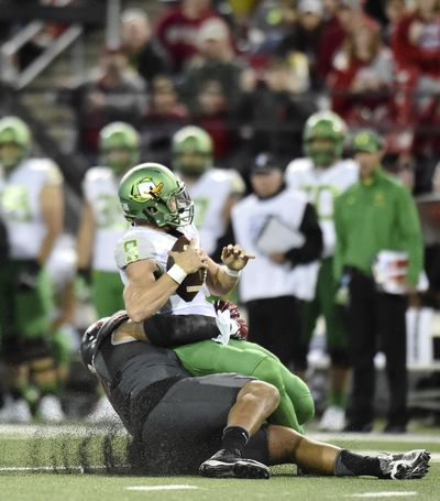 Washington State Cougars nose tackle Robert Barber (92) sacks Oregon Ducks quarterback Dakota Prukop (9) during the first half of a college football game on Saturday, Oct 1, 2016, at Martin Stadium in Pullman, Wash. (Tyler Tjomsland / The Spokesman-Review)