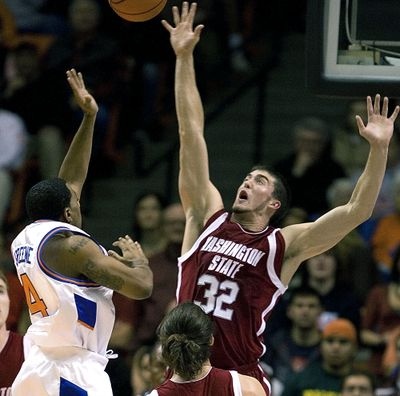 Washington State forward Daven Harmeling (32) reaches to block the shot of Boise States' Jamar Greene (4) during the second half of the college basketball game Tuesday, Nov. 13, 2007, in Boise Idaho. Washington State went on to win 86-74.  (Associated Press)