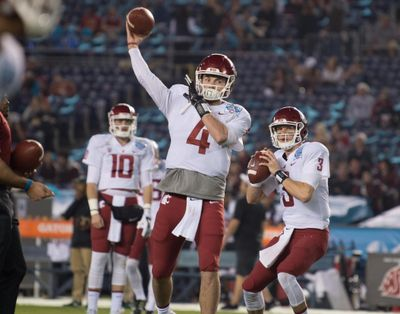Washington State Cougars quarterbacks Luke Falk (4) and Tyler Hilinski (3) warm up before the first half of the 2017 Holiday Bowl Thursday, December 28, 2017, at SDCCU Stadium in San Diego, Calif. Falk did not play in the game. (Tyler Tjomsland / The Spokesman-Review)