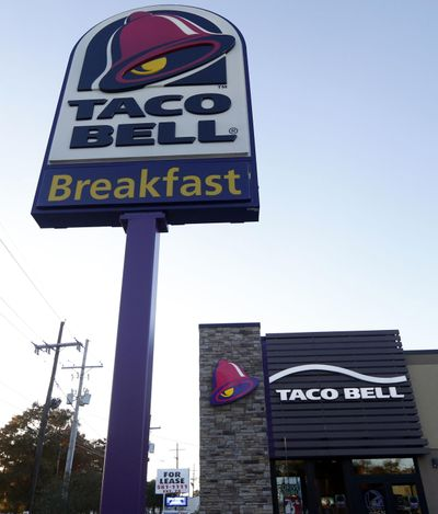 This Dec. 15, 2016, file photo shows a Taco Bell restaurant in Metairie, La. Robert L. McKay, who designed the first Taco Bell restaurant and with founder Glenn Bell turned it from a quirky food stand into a fast-food empire, died last week. (Gerald Herbert / Associated Press)