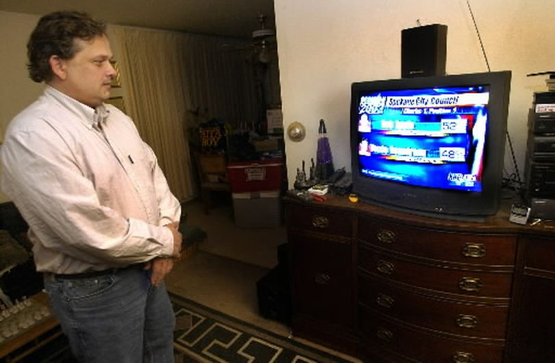 At his home, Bob Apple , candidate for council district 1 watches early results of him leading opponent Terry Beaudreau. (Colin Mulvany)