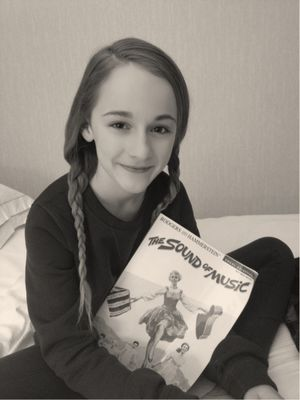 """Sophia Anne Caruso holds her copy of the original Broadway musical score of """"The Sound of Music."""" (Photo courtesy of Deena Caruso)"""