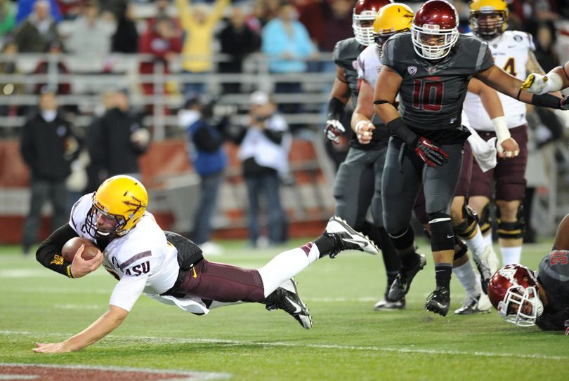 Arizona State quarterback Taylor Kelley (10) dives with the ball for a touchdown against Washington State during the first half of a college football game on Thursday, October 31, 2013, at Martin Stadium in Pullman, Wash. (Tyler Tjomsland / The Spokesman-Review)