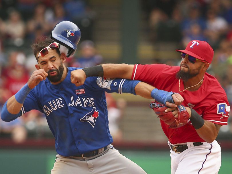 Toronto Blue Jays Jose Bautista (19) gets hit by Texas Rangers second baseman Rougned Odor (12) after Bautista slid into second in the eighth inning of a baseball game at Globe Life Park in Arlington, Texas. (Richard W. Rodriguez / Associated Press)