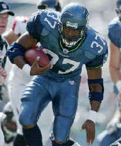 Seattle's Shaun Alexander rushed for 144 yards and a touchdown.  (Associated Press / The Spokesman-Review)