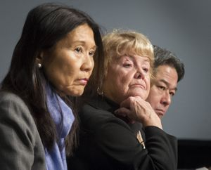 Members of the Washington State Liquor Control Board, from left, Ruthann Kurose, Sharon Foster and Chris Marr, listen during a public forum on implementing I-502 at the Spokane Convention Center on Tuesday. (Colin Mulvany)