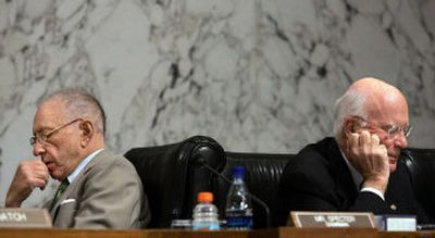 Senate Judiciary Committee Chairman, Sen. Arlen Specter, R-Pa., left, and Sen. Patrick Leahy, D-Vt., ranking Democrat on the committee, go over notes separately during the confirmation hearing for Chief Justice nominee John Roberts Thursday.   (Associated Press / The Spokesman-Review)