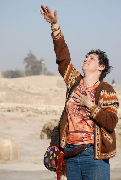 In this photo provided by Danielle Desnoyers, spiritual seeker Star Charney, 56, performs her own prayer outside the Great Pyramid at Giza, Egypt on March 3.  (Associated Press / The Spokesman-Review)