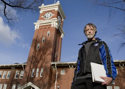 Rich Alldredge, a Washington State University professor of statistics and the president of WSU's chapter of the American Association of University Professors, holds a folder of national and state AAUP bylaws Friday in front of Byron Clock Tower on the Pullman campus.Special to The Spokesman Review (TYLER TJOMSLAND Special to The Spokesman Review / The Spokesman-Review)