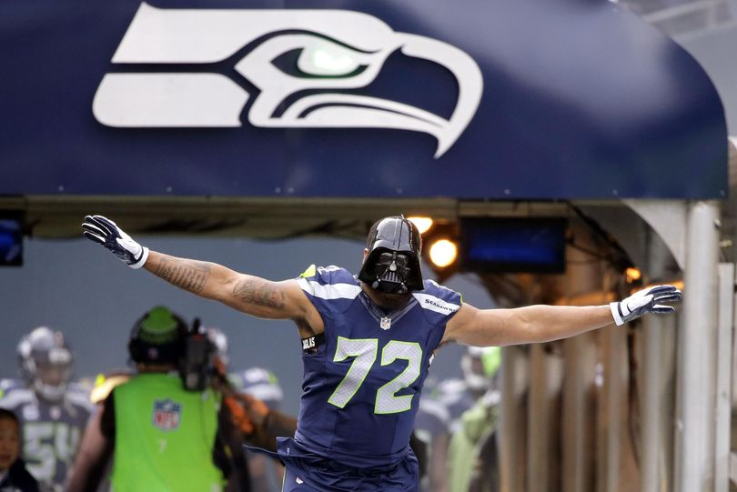 """Seattle Seahawks defensive end Michael Bennett, donning a """"Darth Vader"""" mask before the Cleveland game in December, says the Seahawks just needed time to get back into form this season. (Ted Warren / Associated Press)"""