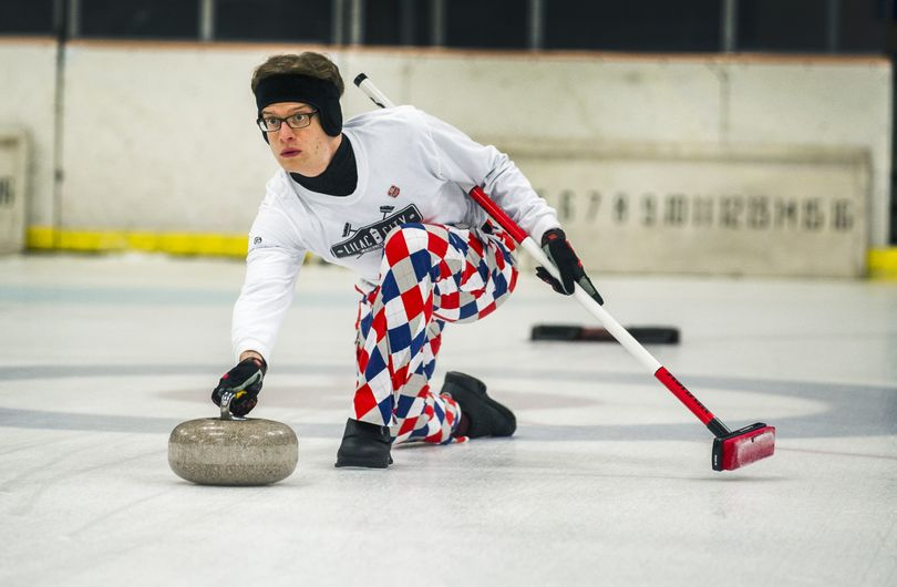 During curling practice at the Riverfront Park Ice Palace, Josh Engle throws a stone. For the first time in 30-some years, Spokane has a curling league. The new league is full of new curlers, with 80 percent of participants having never curled before. (Colin Mulvany)