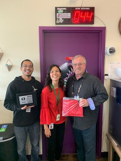 In partnership with Benton-Franklin Health District and Educational Service District 123, cannabis retailer Green2Go began distributing free lockboxes to prevent underage marijuana use in October 2019. From left, Green2Go General Manager Manny Longoria; Vanessa McCollum, Benton-Franklin County Public Health Educator; and Mike Mahaffey, Green2Go HR Gen/COS. (Courtesy Green2Go)