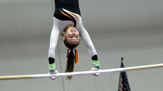 Lewis and Clark's Lyra Mylroie competes on the uneven bars during Wednesday's GSL gymnastics championships at Mead Gymnastics Center.  (Kathy Plonka/The Spokesman-Review)