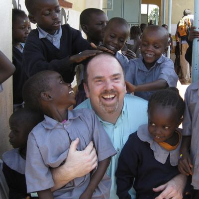This 2011 photo provided by Greg Eubanks, CEO of an adoption agency in Washington state called WACAP, shows him surrounded by students from a community elementary school in Nairobi, Kenya. In 2018, Eubanks says his agency, and other U.S. adoption agencies dealing in international adoption, face difficulties ahead because of higher fees and tougher regulations being imposed by the U.S. State Department. (AP)