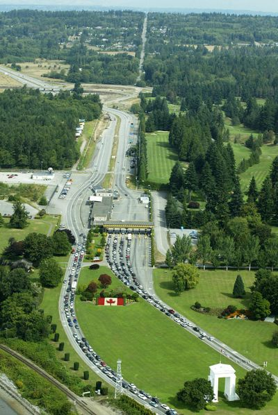The Peace Arch, lower right, is shown from the air at the U.S. - Canada border crossing at Blaine, Washington, in this August 2004 photo. U.S. Customs and Border Protection said Sunday it had not issued orders to stop Iranian-Americans at the border amid escalating tensions between the U.S. and Iran. (TED S. WARREN / AP)