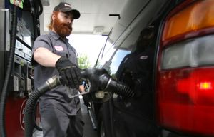 A gasoline attendant pumps gas Wednesday in Portland. Oil prices hit a six-month high Wednesday, climbing above $62 a barrel.  (Associated Press / The Spokesman-Review)