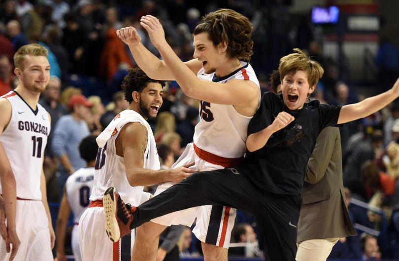 Gonzaga's bencher Rem Bakamas, second from right, celebrates his one minute of substitution and successful three-pointer at the end of the game against Loyola Marymount, Wednesday, Dec. 23, 2015 at McCarthey Athletic Center at Gonzaga University. The Gonzaga Bulldogs won 85-62. (Jesse Tinsley / The Spokesman-Review)